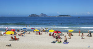 People relax on Ipanema Beach at Rio de Janeiro in Brazil. Royalty Free Stock Photos