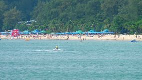 High season in Karon beach in Phuket. People relax on Karon beach. This is one of the most popular beaches among tourists in Phuket stock video