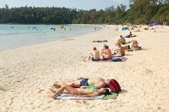 People relax on Kata Beach Royalty Free Stock Photos