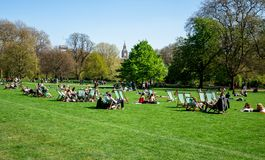 People relax in London St James Park with Big Ben seen in backgr Royalty Free Stock Photography