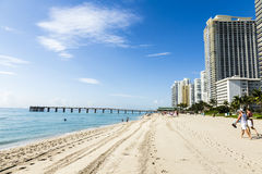 People relax near the pier in Sunny Isles Beach. SUNNY ISLES BEACH, USA - JULY 28, 2013: people relax near the pier in Sunny Isles Beach, USA. In 1936, Milwaukee Stock Images