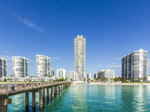People relax near the pier in Sunny Isles Beach Stock Photo
