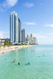 People relax near the pier in Sunny Isles Beach. SUNNY ISLES BEACH, USA - JULY 28, 2013: people relax near the pier in Sunny Isles Beach, USA. In 1936, Milwaukee Royalty Free Stock Photo