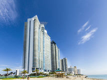 People relax near the pier in Sunny Isles Beach Royalty Free Stock Images