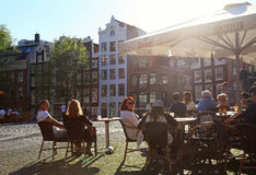 People relax in the outdoor cafe, Amsterdam Stock Images