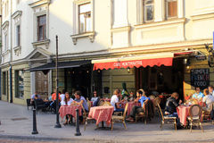 People relax at outdoor Cafe Montmartre in the Old Town, Vilnius Stock Photo