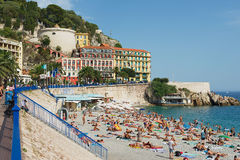 People relax at the public beach in Nice, France. Stock Image