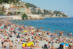 People relax at the public beach in Nice, France. Royalty Free Stock Photography