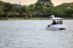 People ride duck boat at public park name Suan Luang Rama IX on sunset time Bangkok, Thailand. People relax ride duck boat at public park name Suan Luang Rama royalty free stock photo