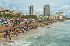 People relax at the seaside in Colombo, Sri Lanka. Stock Photo