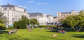People relax at Sigmund-Freud Park in Vienna Stock Photos
