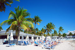 People relax at the sunny South Beach of Key West. Key West, United States - February 6, 2016: People relax at the sunny South Beach of Key West near Atlantic Stock Images