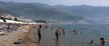 People relax and swim on the beach of the Adriatic Sea Stock Photo