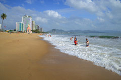 People relax and swim on the beach of Nha Trang. Vietnam Royalty Free Stock Image
