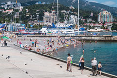 People relax and swim at the beach in Yalta Stock Image