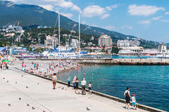 People relax and swim at the beach in Yalta Royalty Free Stock Photography