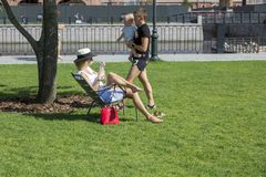 People relax in the territory of the city park `New Holland` in St. Petersburg stock photography