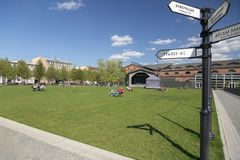 People relax in the territory of the city park `New Holland` in St. Petersburg stock photos