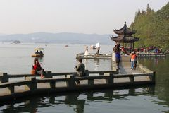 People relax along the Unesco West lake in Hangzhou, China Royalty Free Stock Images