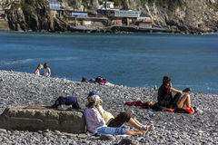 People relaxing on the beach in Camogli in Italy Stock Photo