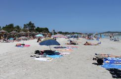 People relaxing on beach in Majorca Stock Photography