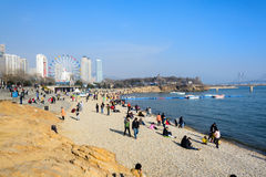 People relaxing at the beach at xinghai park Stock Images