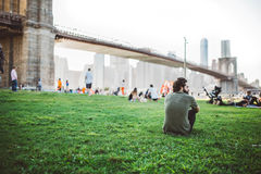 People relaxing by Brooklyn Bridge