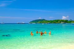 People relaxing on a Bundhaya beach koh lipe ,Thailand, in December 23, 2018 royalty free stock photography