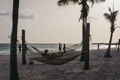 People relaxing in Carlisle Bay beach, Bridgetown, Barbados, at dusk. royalty free stock photography