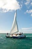 People relaxing on catamaran Stock Image
