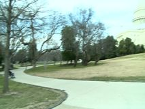 People relaxing in city park stock footage