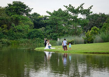 People relaxing at the city park in Singapore Stock Photo