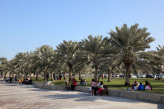 People relaxing on the corniche, Doha Royalty Free Stock Photo