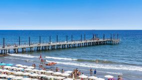 People relaxing on crowded beach. Alassio SV, ITALY - August 22, 2017 Royalty Free Stock Photo