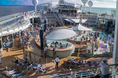 People relaxing on cruise ship pool deck Royalty Free Stock Photo