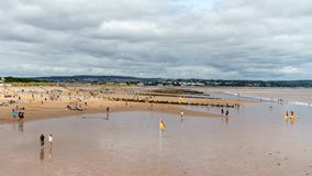 People relaxing on the Dawlish Warren Beach, Devon, United Kingdom, August 20, 2018 stock photography