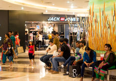 People relaxing delhi shopping malls. Delhi, India - 10th April 2016: People relaxing inside shopping malls in Delhi Gurgaon. With the heatwave in the city malls Royalty Free Stock Images