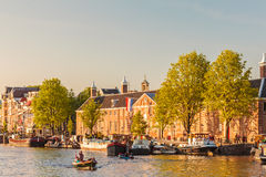 People relaxing on the Dutch Amstel river with the Hermitage mus Royalty Free Stock Photos