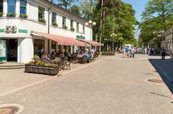People relaxing and enjoying outdoor bar at the Jomas Street in the center of Maiori in Jurmala, Latvia Stock Image