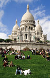 People relaxing in front of Basilique du Sacre Coeur Royalty Free Stock Image