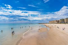 People relaxing on Glenelg beach on sunny day Stock Photos