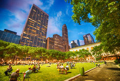 People relaxing on the grass of Bryant Park on a beautiful eveni Royalty Free Stock Photography