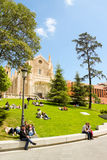 People relaxing on the grass near El Prado museum and St. Jerome Royalty Free Stock Photos