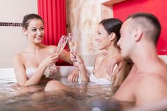 People relaxing in the hot tub Royalty Free Stock Photos