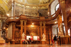 People relaxing inside the Austrian National Library with old luxury furniture Stock Image