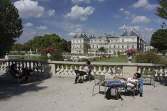 People relaxing in Jardin de Luxembourg, Paris Stock Photos