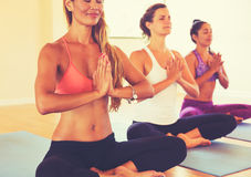 People Relaxing and Meditating in Yoga Class. Royalty Free Stock Photos