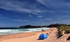People relaxing on Mona Vale beach Stock Photo