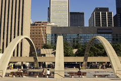 People relaxing on Nathan Phillips Square in Toronto Royalty Free Stock Image