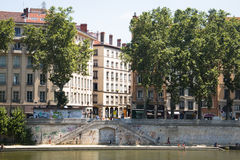 People relaxing near the Saone river in Lyon, France Stock Photo